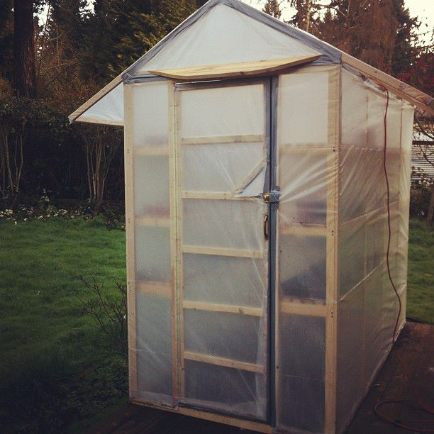 Here is the outside of the completed greenhouse. It not rests on our back porch. We have a light we run into it but so far... we havent needed to use it.