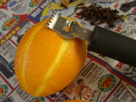 A zester works great in the process, but you can use a small knife to score the fruit.