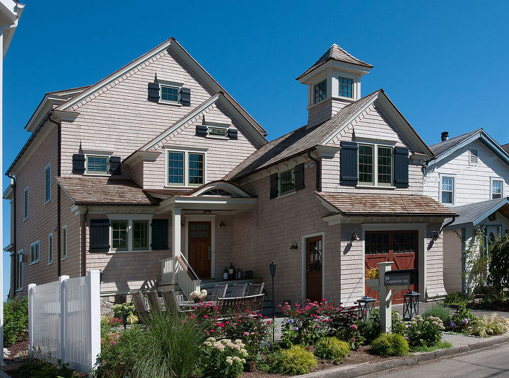 Front View of Harbor View Home Renovation by Titus Built, LLC The exterior of the home is a strategically planned marriage of desirable aesthetics and practical considerations.