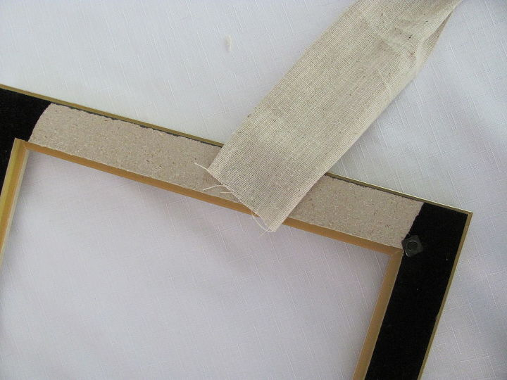 Use a hot glue gun to glue the fabric onto the back of the frame ..