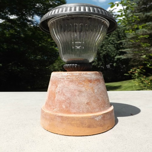 Put a Solar Lamp in a Terra Cotta Pot for a Table Lamp