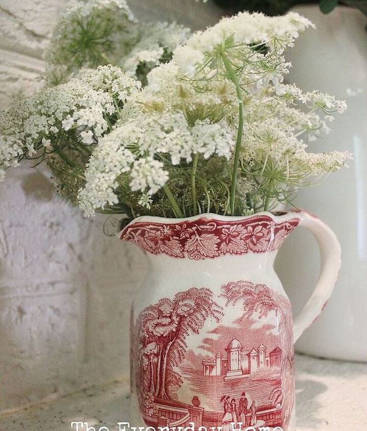A small pink and white Staffordshire pitcher filled with more lacy blooms.