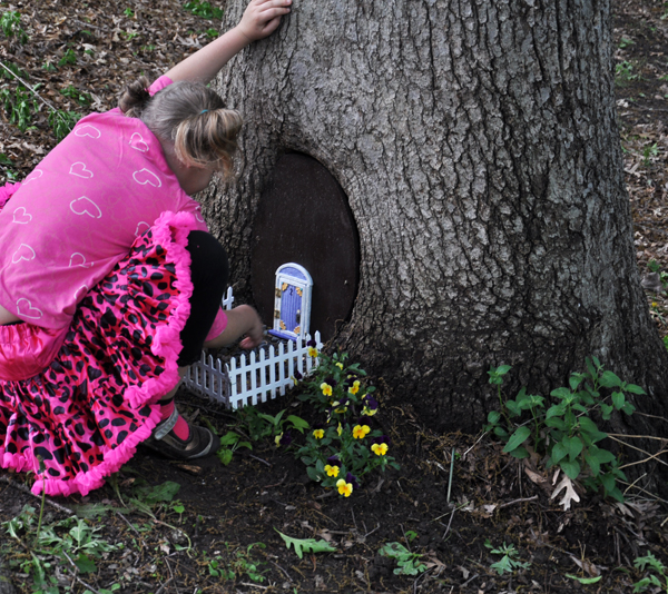 Granddaughter Reagan finds the fairy house. A very exciting time!