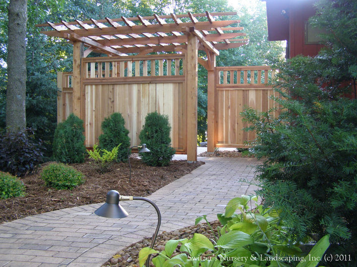 Night lighting always enhances any landscape project.  The path lights help lead the way... enjoy your evening in your wonderful backyard with a little privacy.