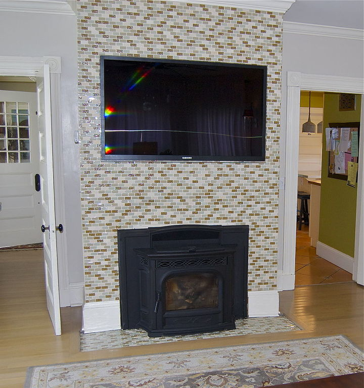 Tile accent wall. I did this working around and up to the tv mount since the television hides the edge around the mount.
