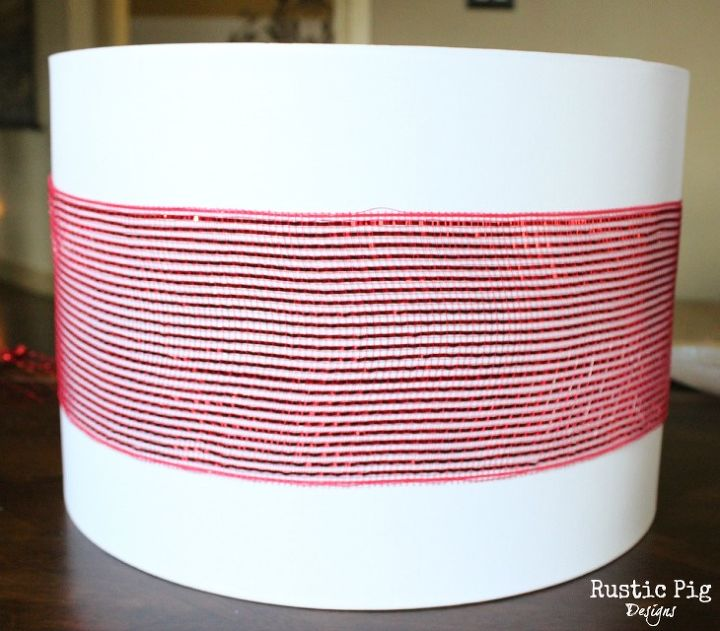 Step Two:  Wrap red Deco Mesh Ribbon around the lamp shade.
