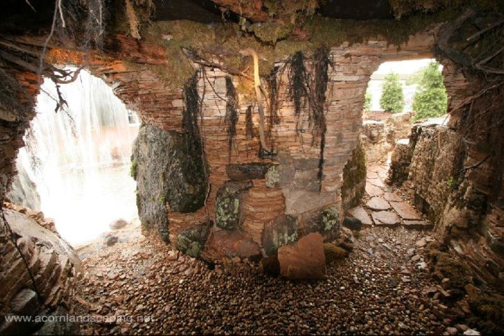This is the Grotto or Cave behind the Waterfalls. Constructed by the largest group of professional Pond Builders in the World:  Certified Aquascape Contractors