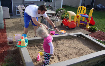 diy sandbox, outdoor living, woodworking projects, Raking and adding of 35 bags of sand