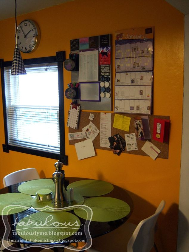 """Our """"information station"""" -- I now have my desk where the table is."""