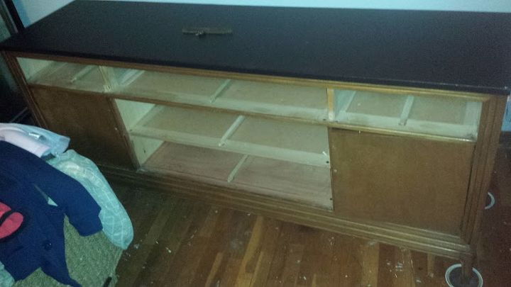 contemplated cuting out the bottom middle two drawers and turning it into a desk but decided to avoid the headache