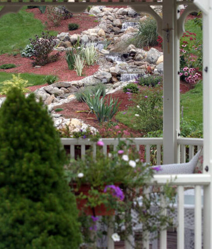 A view of the meandering waterfall from inside the gazebo.