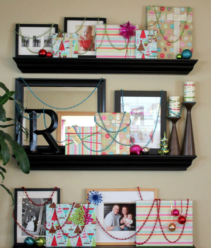 Wrapping paper, ribbon, and a few holiday accessories turn this floor-to-ceiling photo gallery wall into a high impact. gift-wrapped holiday display!