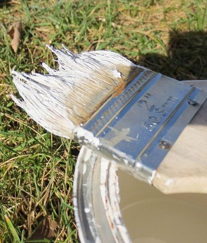 "Dry brush with an inexpensive paint brush and a different color such as white by lightly coating the surface with ""feather strokes"". http://downtoearthstyle.blogspot.com/2013/12/primp-my-primer-distressing-techniques.html"