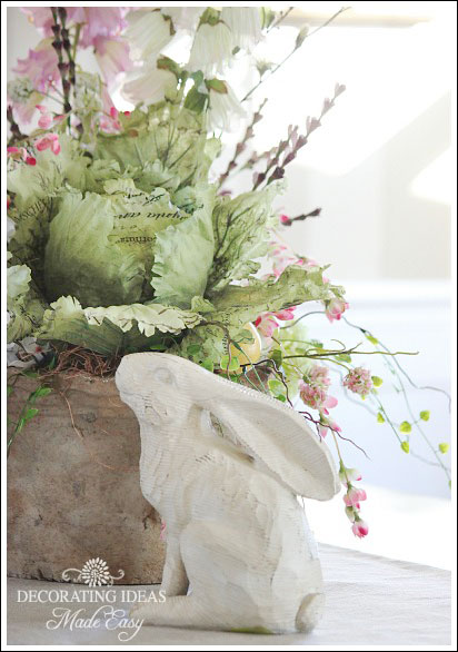 I like flowers and dainty greenery to flow over the container.
