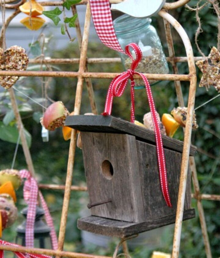 A small birdhouse and bird seed ornaments
