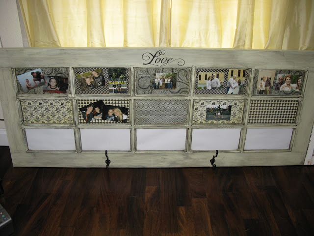 Door with scrapbook paper, pictures and hooks added
