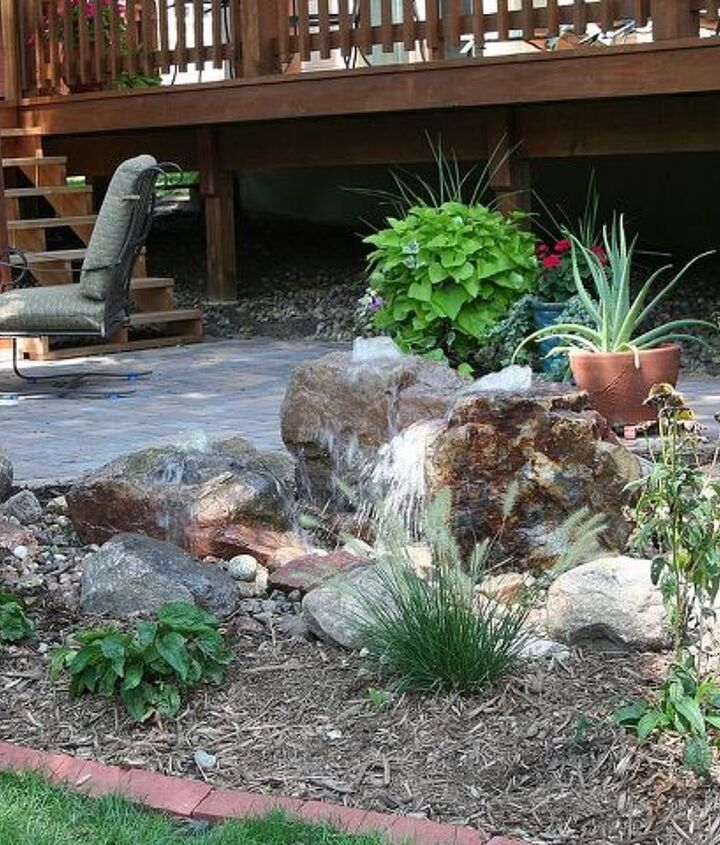 The bubbling water feature adds the soothing sound of water to the outdoor space.  This low maintenance feature allows the homeowner the flexibility to run it on a timer, or shut it off when traveling.  Also a nice bath for the birds.