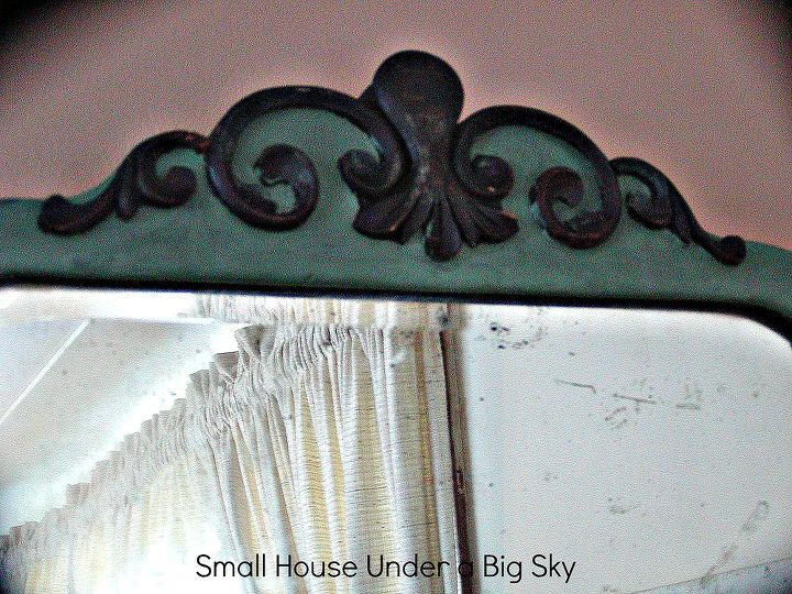 This vintage mirror boosts dark stain on the carved top and chalk paint filling in the rest. Both finishes are hand waxed.