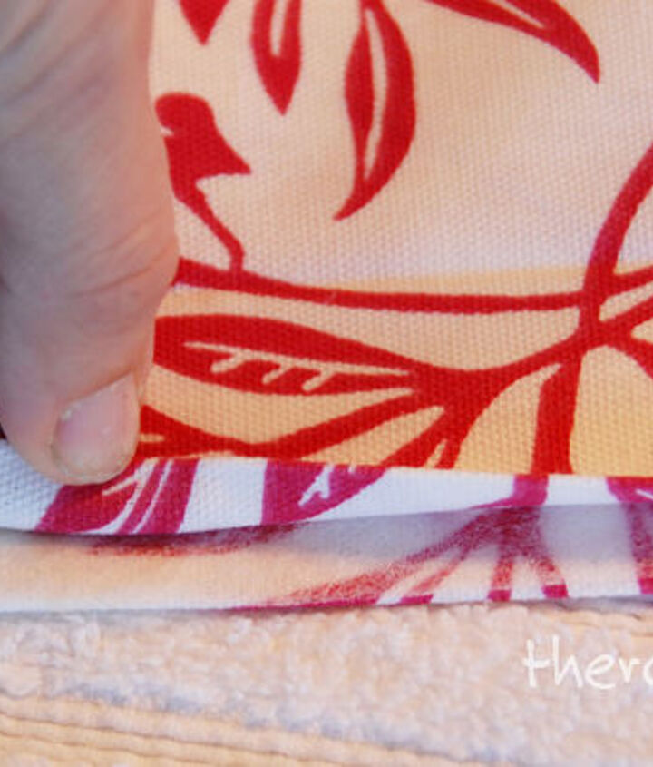 Step 13: Place hem tape between fabric pieces and press.