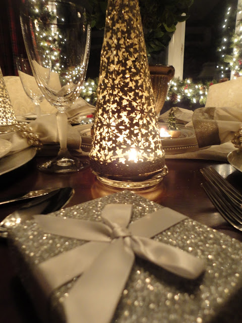 Silver trees from Target set over a votive offers the perfect Christmas glow.