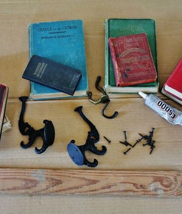 All you need are some discarded books, a scrap board, coat hooks, screws, some glue, plummer's metal tape & wall hangers for the back.