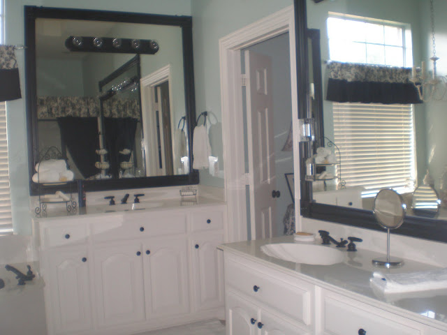 Wood trim around the mirrors added so much punch to the bathroom