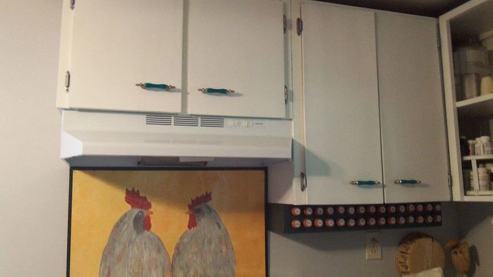 So here is my spice rack.  It is handy, out of the way and saves much needed cabinet space. I painted the chickens.