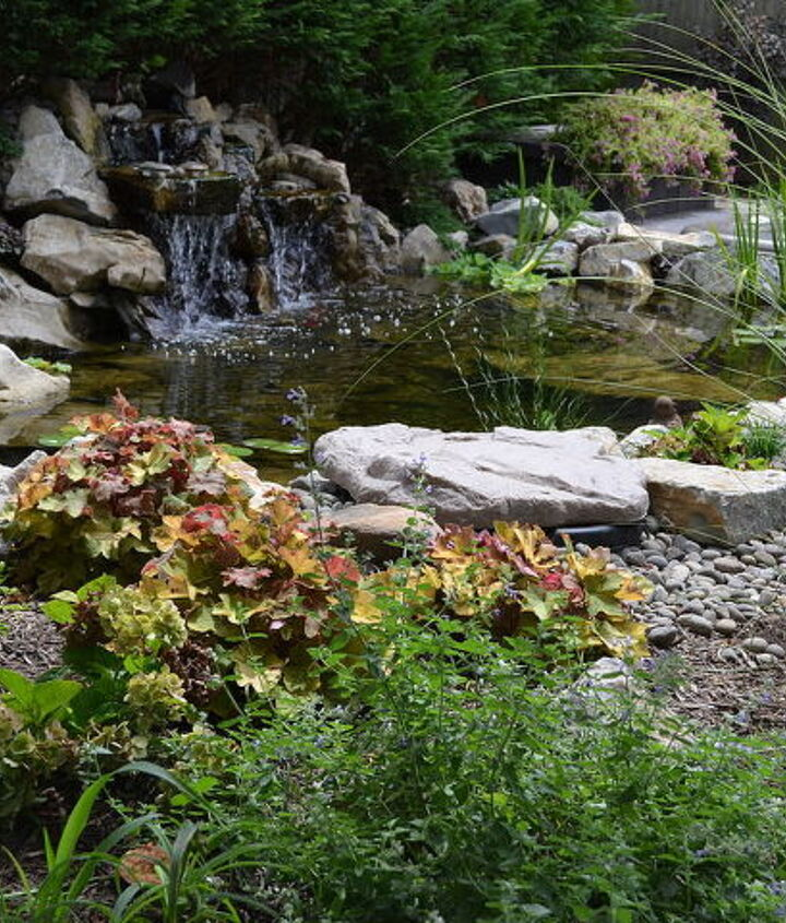 View of the landscaping, pond and waterfall from the patio http://www.deckandpatio.com/DP_Blog/