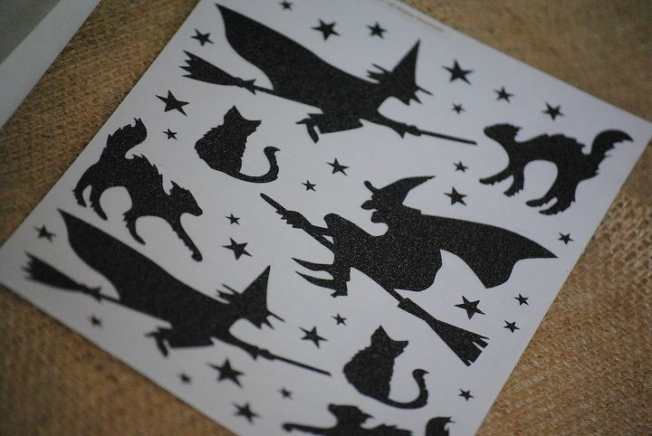 Supplies: * Freezer Paper * Silhouette stickers of Halloween themes or similar die cuts (cats, witches, bats, moons, mice, etc.) * Clear tape * Glass vase * Battery operated tealight candles * Scissors