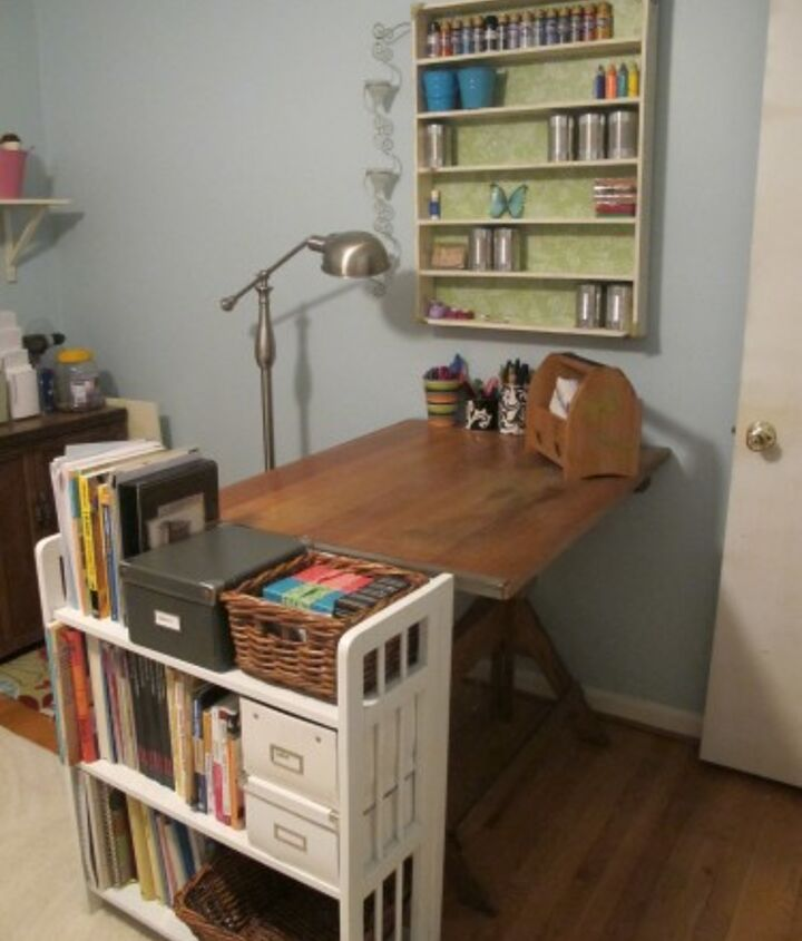 I flanked the end of the drafting table with this $15 yard sale bookcase that I painted while. It holds all my sewing, knitting, and home improvement books.