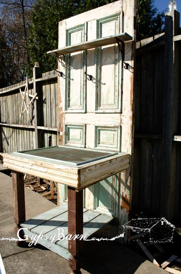 An old door - some old trim and molding, an old screen and some fence boards! Voila! Using a screen for your potting table really helps when it comes to rinsing it off or collecting spilled soil or excess water