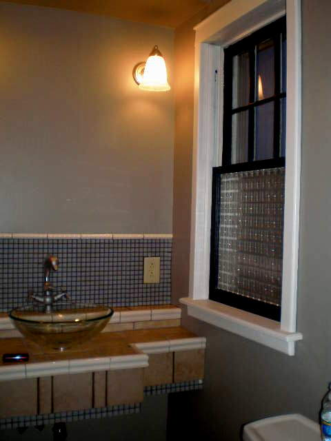 finished tilework and sink installed