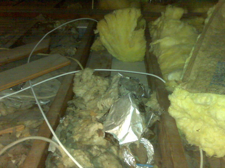 Here again is insulation that was displaced and varied due to all the so called improvements in the attic.