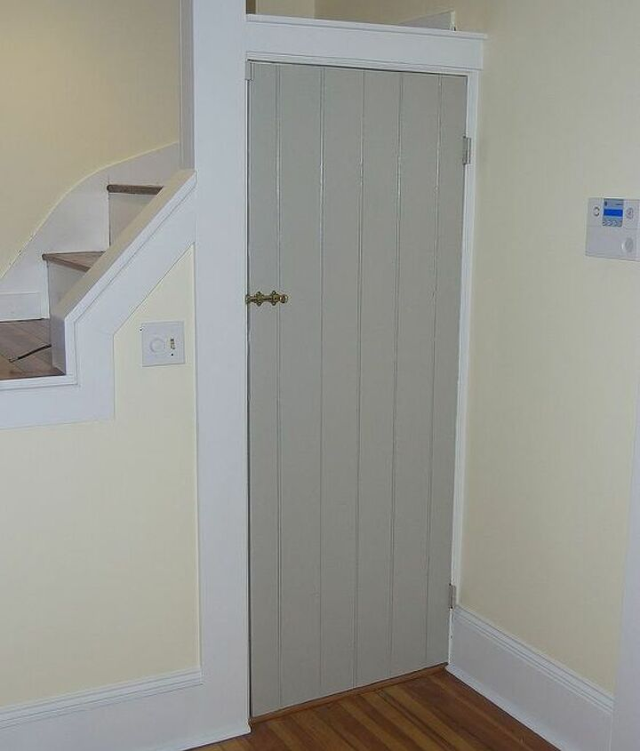 We kept the stairs for now and painted all the interior doors Revere Pewter for contrast and durability