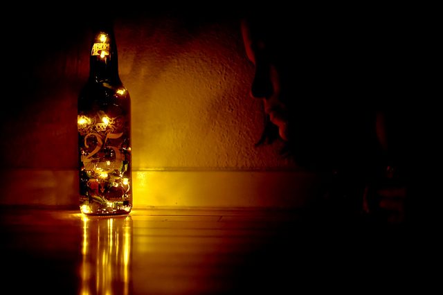 A beer bottle stuffed with a string of white lights makes for romantic lighting. Photo: nanny snowflake/flickr