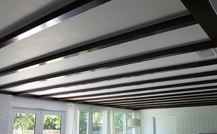 exposed beam ceiling before and after, diy, home improvement, paint colors, woodworking projects, Exposed beam ceiling reveal Dark stained beams finished and insulated in between The beams match the floors throughout the house and the white paint opens up the space even more