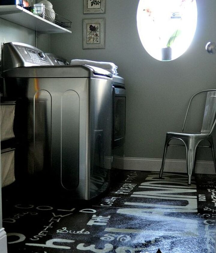 laundry room with painted subway art concrete floors