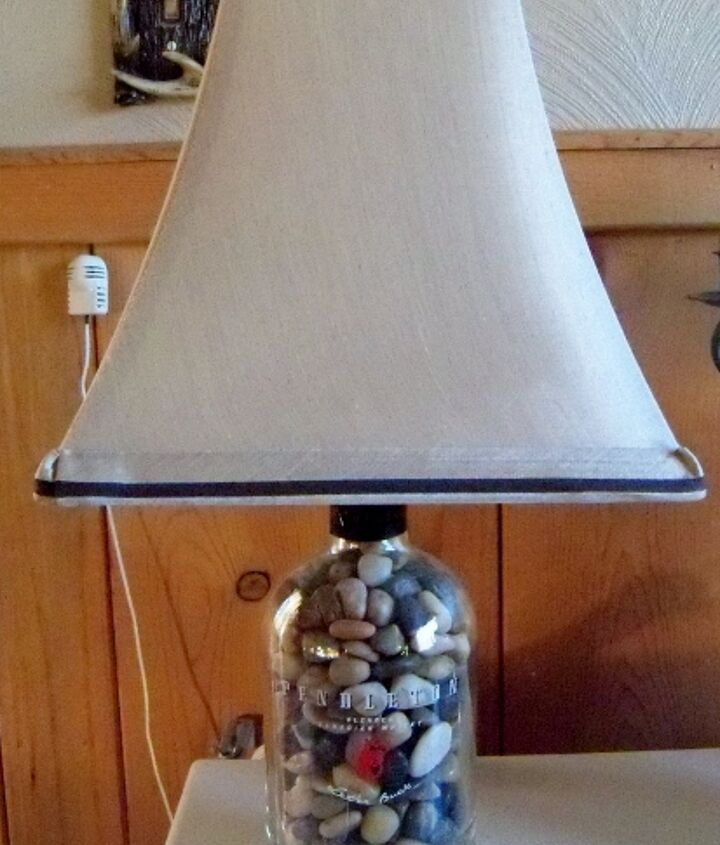 Filled with polished rocks, added a tan with brown trim shade.  Nice lamp.