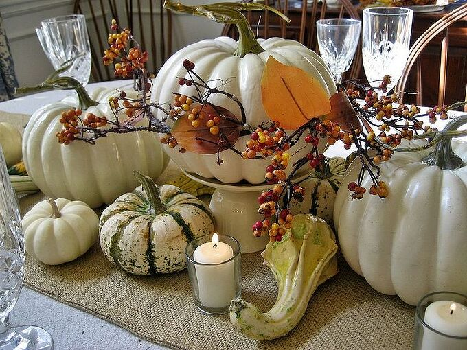 thanksgiving tablescape burlap and white pumpkins, home decor, seasonal holiday decor, thanksgiving decorations, An overturned teacup topped by its saucer elevate the center pumpkin