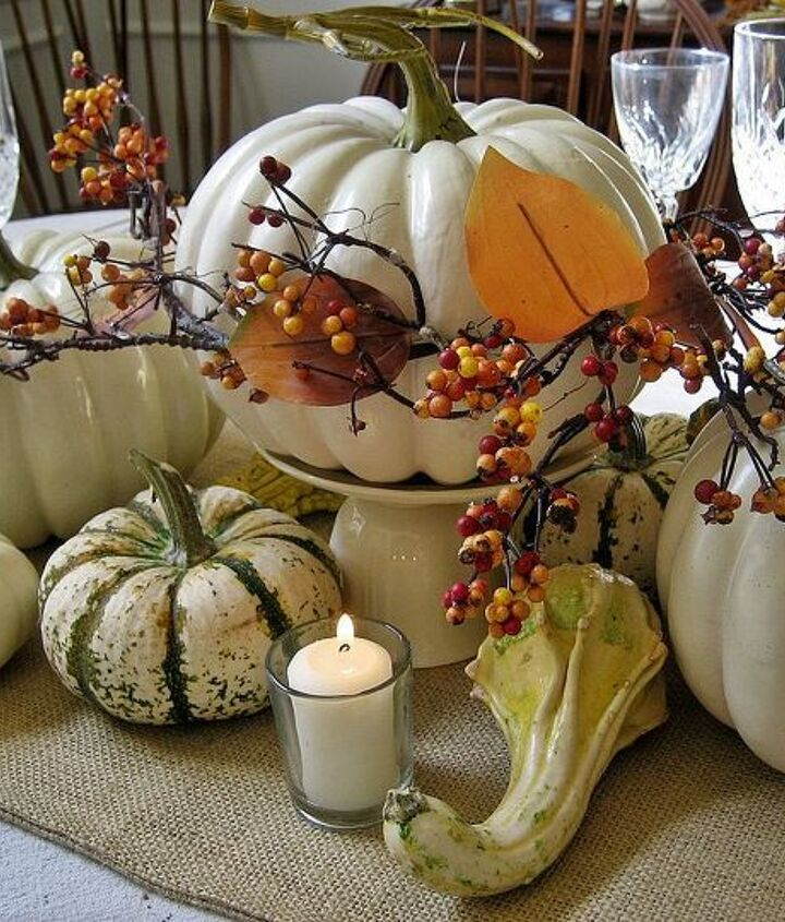 An overturned teacup topped by its saucer elevate the center pumpkin