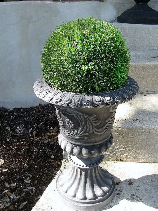 I added a couple new urns and more faux greenery orbs!