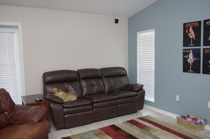 Wall on left, behind couch.