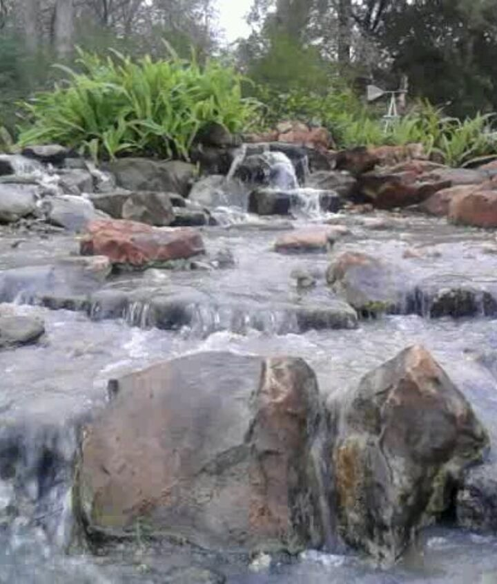 Amazing waterfalls and stream installed on a natural pond near Houston, Texas.