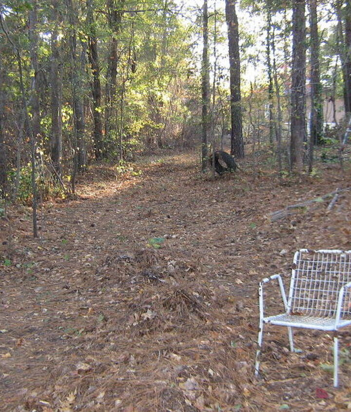 This is the beginning of the road at the beginning of the south property line.  This is actually the second landing.  To the left is a steep drop-off.  To the right you go up the hill to my house.