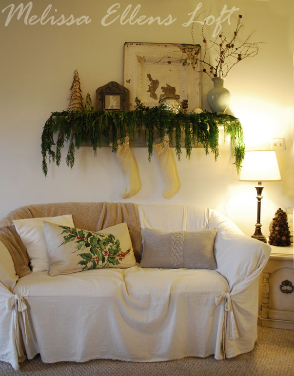 mantel shelf with fresh greens, vintage stockings, old ceiling tile, drummer boy silhouette...