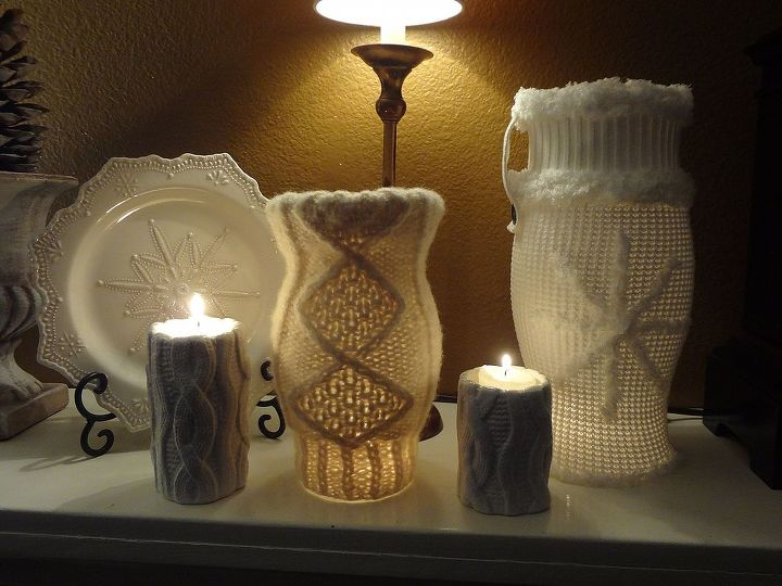 I also covered a pair of smaller hurricane globes with sleeves from another Goodwill sweater. The two small ceramic white candle holders in this picture came from the after Christmas sale at JoAnn's.