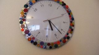 q what to do with old vintage buttons, crafts, repurposing upcycling, This is an ordinary kitchen clock where I have simply used silicone to attach the buttons