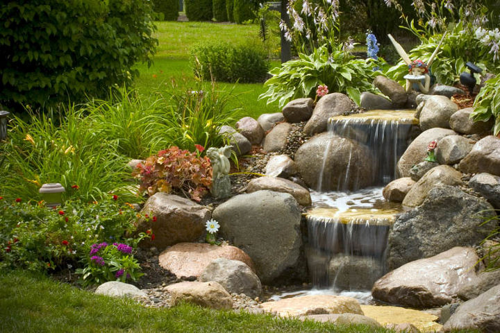A small waterfall adds beauty to an unused corner of the yard.