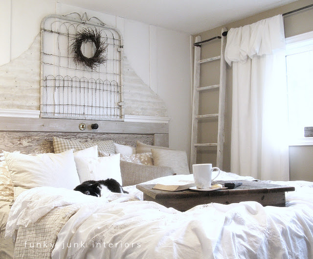 An old gate and door, trimmed out with some painted metal siding became part of a whimsical shabby retreat for this white bedroom makeover.  Visit post at: http://www.funkyjunkinteriors.net/2009/11/bedroom-makeover-part-3-reveal.html