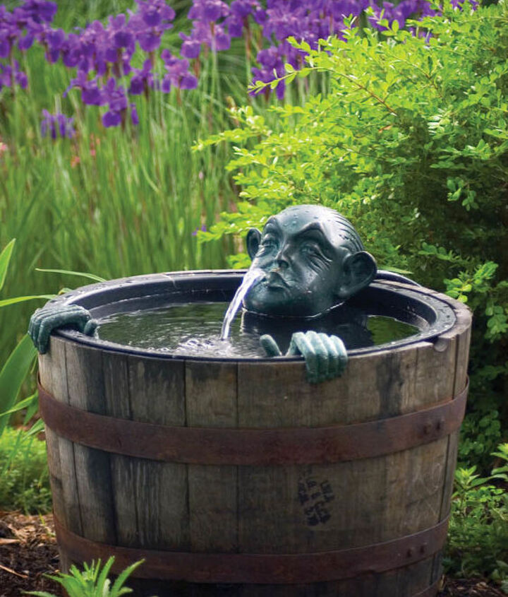 Man in a barrel adds whimsy to the garden.